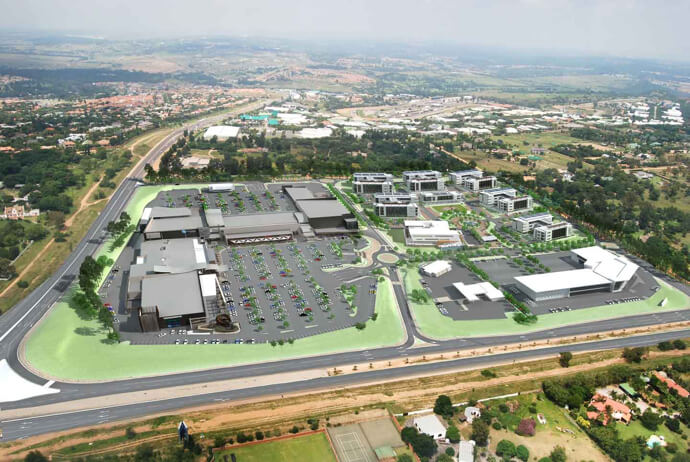 Computer rendering of aerial view of Kyalami Corner Shopping Centre building and parking lot managed by Dorpstraat Properties