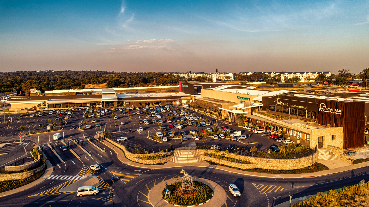 Aerial view of Kyalami Corner Shopping Centre building and parking lot in Witpoort