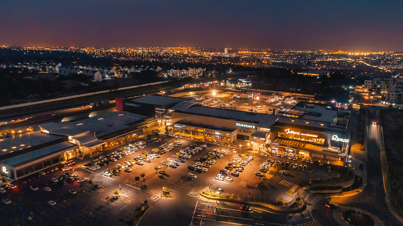 Aerial view of Kyalami Corner Shopping Centre at night managed by Dorpstraat Properties