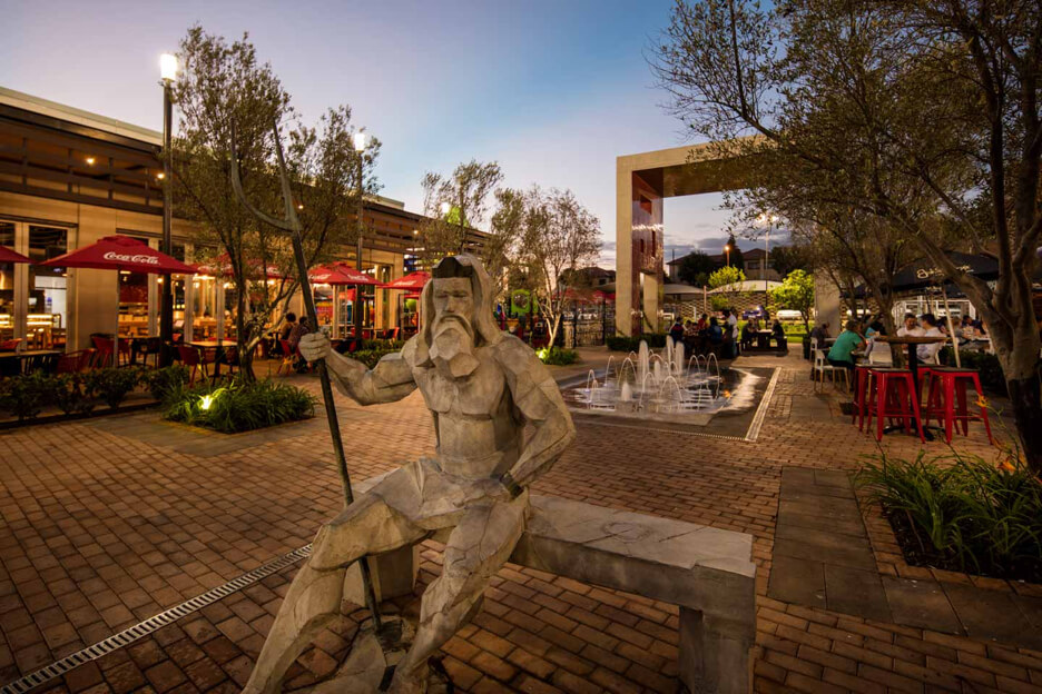 Sculpture of man sitting on a bench at Olympus Square in Pretoria East