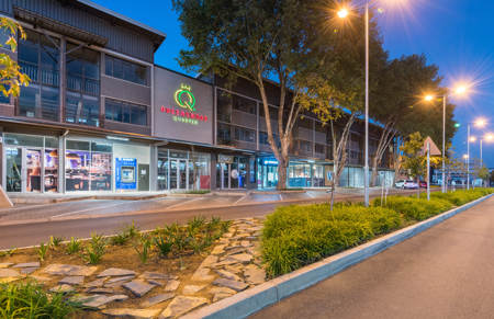 Main entrance of Queenswood Quarter in Pretoria at dusk